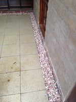 Termite treatment with pebble border